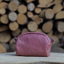 oud roze leren toilettasje